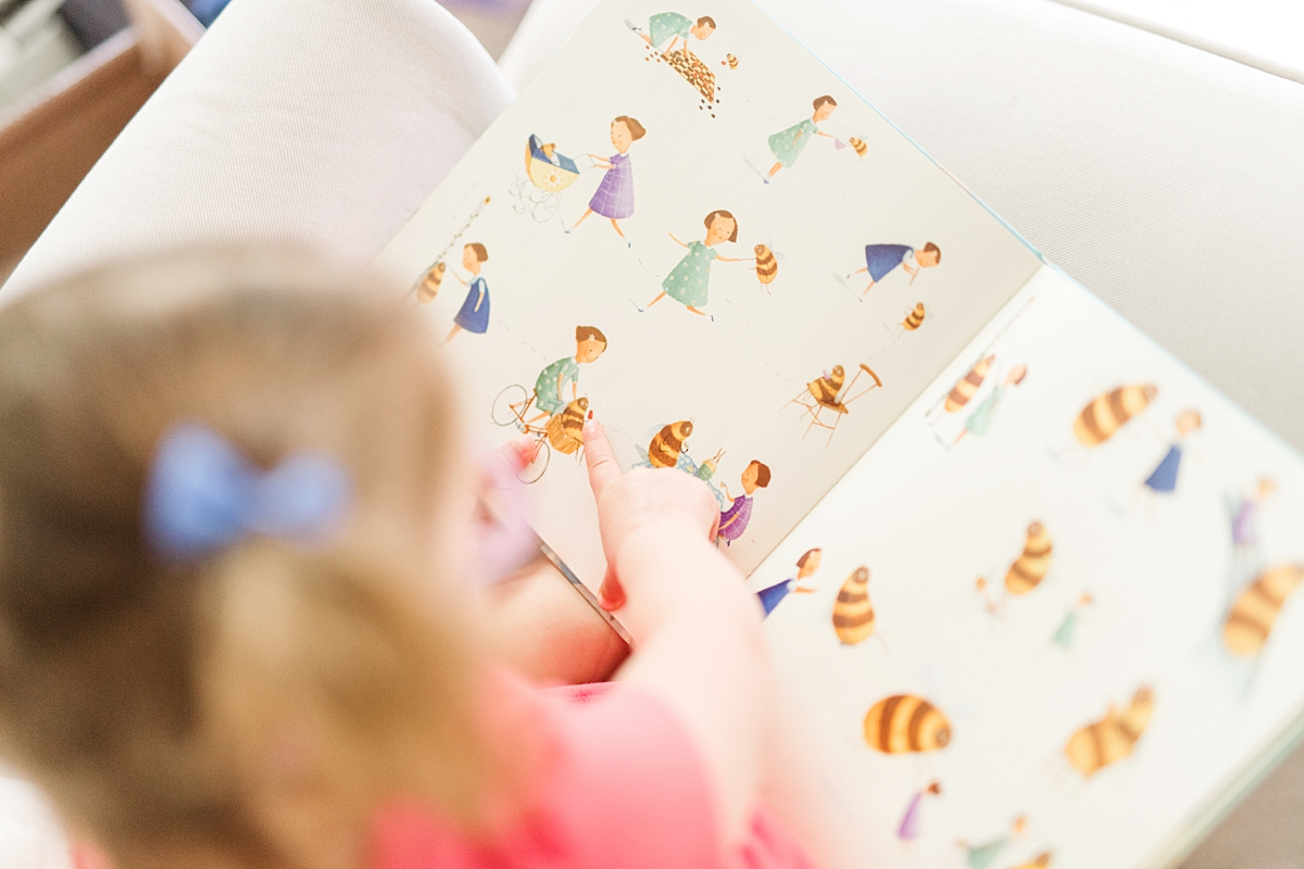 toddler pointing at illustrations